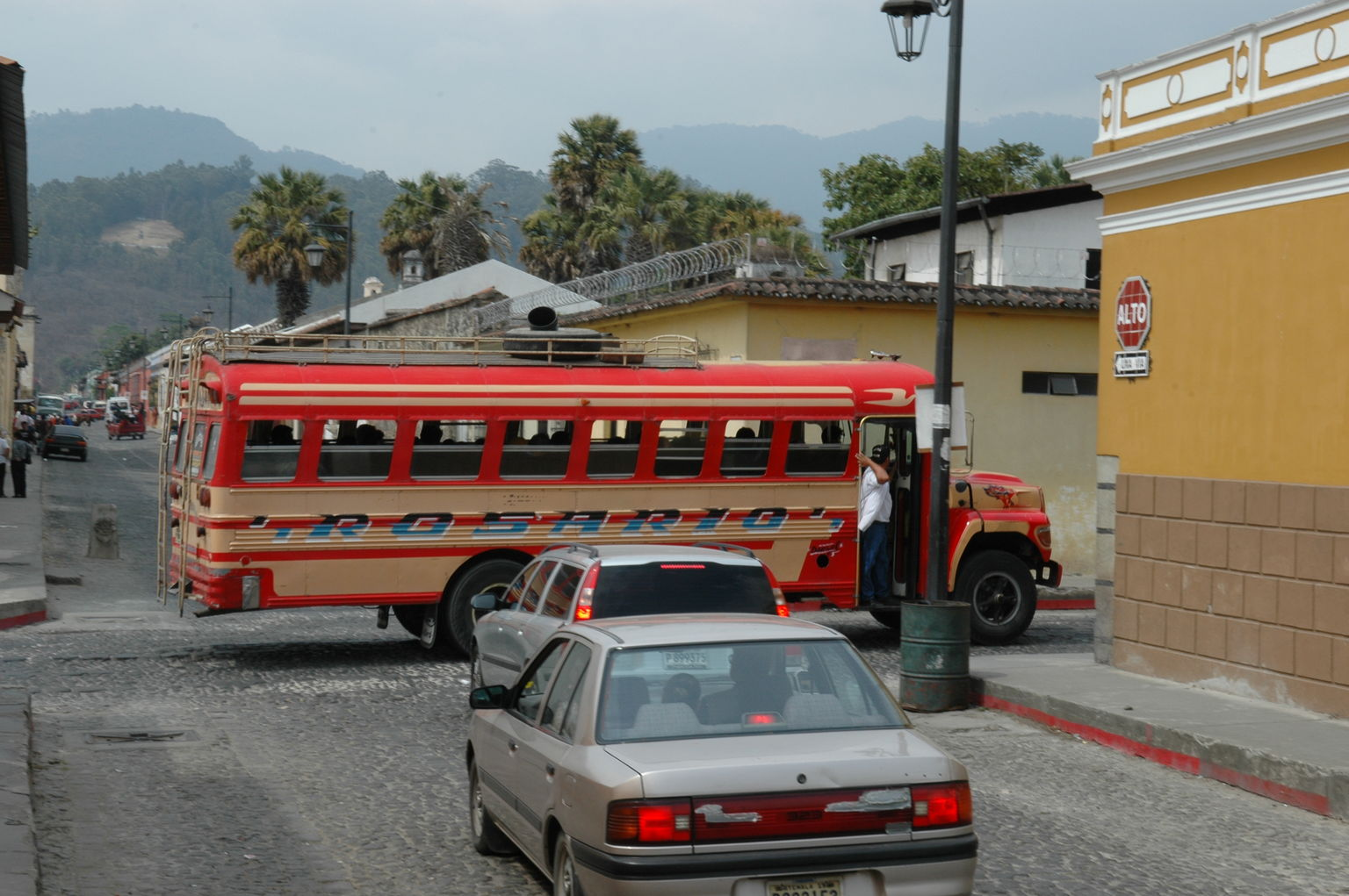 As the chicken buses careened through the streets of Guatemala, an intrepid individual would often hang out the open door to motion to traffic and pedestrians to get out of the way, providing a convenient and friendly way of letting people know their lives were in danger.