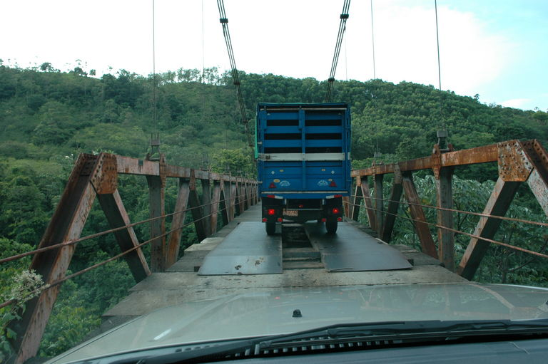 It's always fun to go over a rickety one-lane bridge with holes in it sometimes covered with metal plates with a truck on there with you.  Don't mind the bouncing; it's normal.