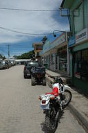 Downtown Santa Elena, close to the Monteverde Cloud Forest.  In the foreground you can see the preferred method of transport, the dirtbike.  Note the large shock absorbers and knobby tires.