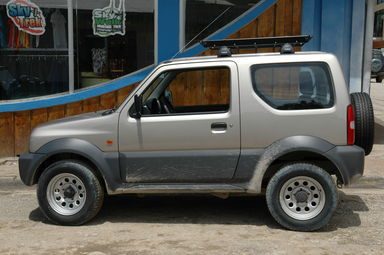 Our intrepid Suzuki Jimny, before it got dirty.  The 1500km we put on this car (it only had 1000km on it when we got it) in 9 days must have taken a good year out of its useful life.  We're sorry, Dollar rent-a-car.